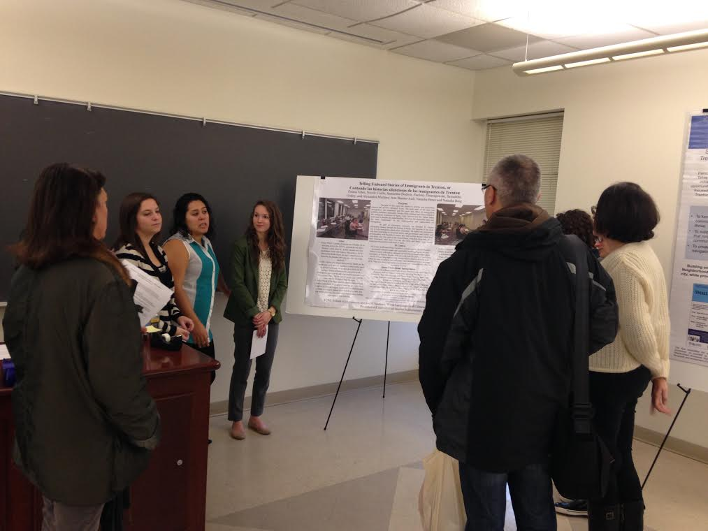 Students from Dr. Ann Warner-Ault's Spanish 302 course on immigration present their poster at the Celebration of Student Achievement.