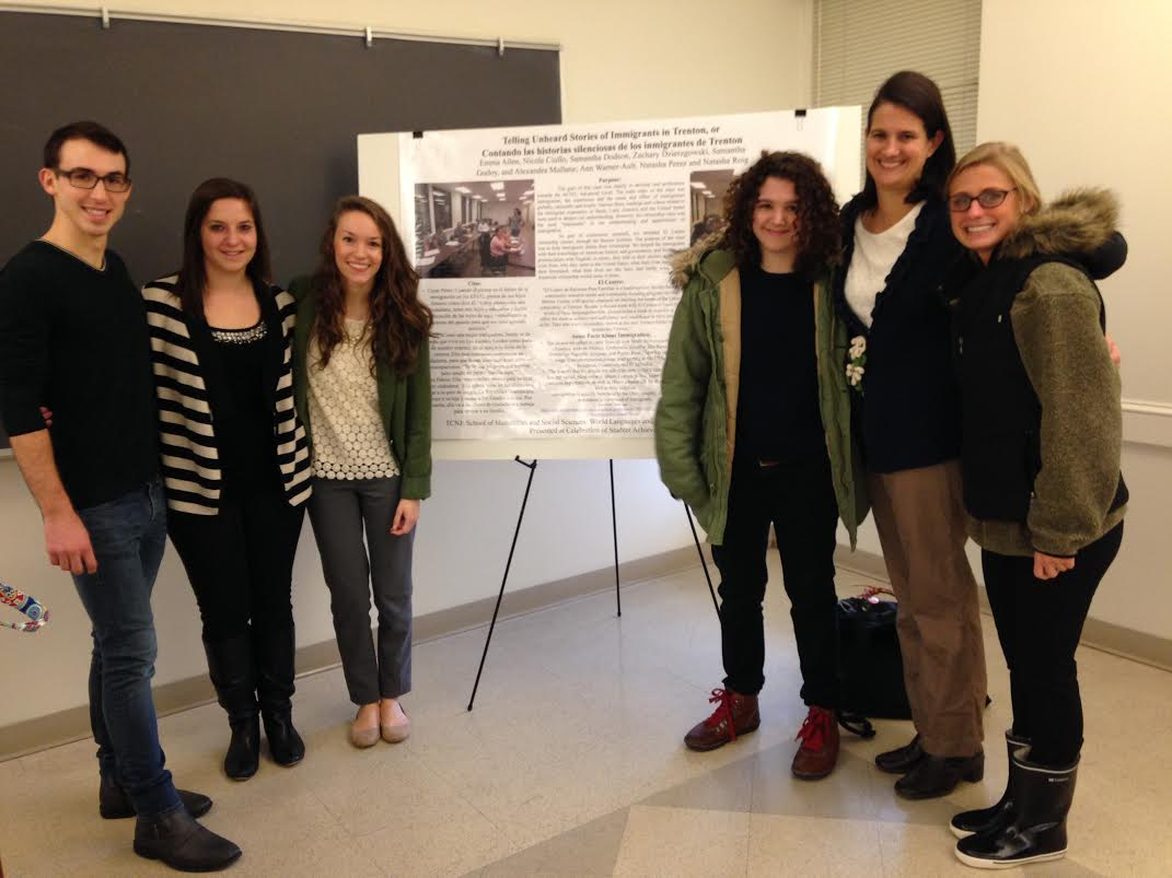 """Students from Dr. Ann Warner-Ault's Spanish 302 course on immigration present their poster entitled, """"Telling Unheard Stories of Immigrants in Trenton"""" at the Celebration of Student Achievement."""